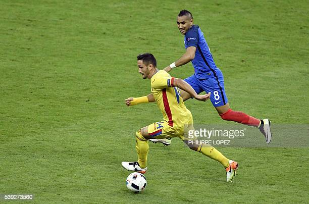 Romania's forward Florin Andone vies for the ball with France's forward Dimitri Payet during the Euro 2016 group A football match between France and...