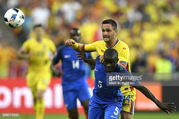Romania's forward Florin Andone vies for the ball with France's midfielder N'Golo Kante during the Euro 2016 group A football match between France...