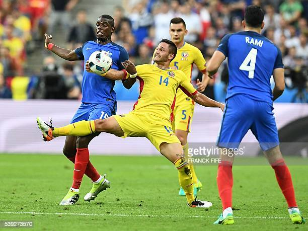 Romania's forward Florin Andone vies for the ball with France's midfielder Paul Pogba and France's defender Adil Rami during the Euro 2016 group A...