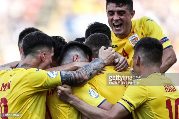 Romania's forward George Puscas and teammates celebrate after he scored a penalty during the semifinal match of the U21 European Football...