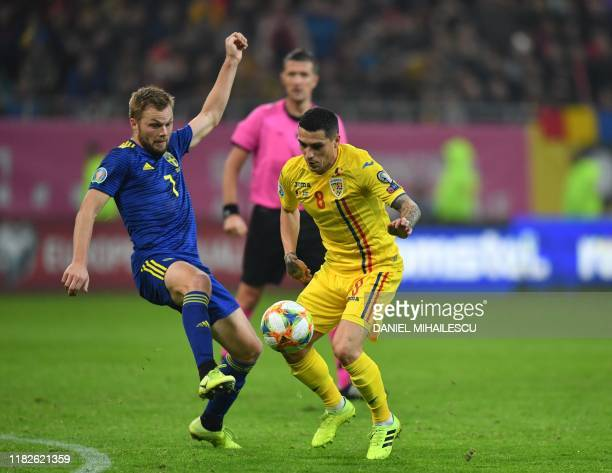 Romania's forward Nicolae Stanciu vies for the ball with Sweden's midfielder Sebastian Larsson during UEFA EURO 2020 qualifier football match on The...