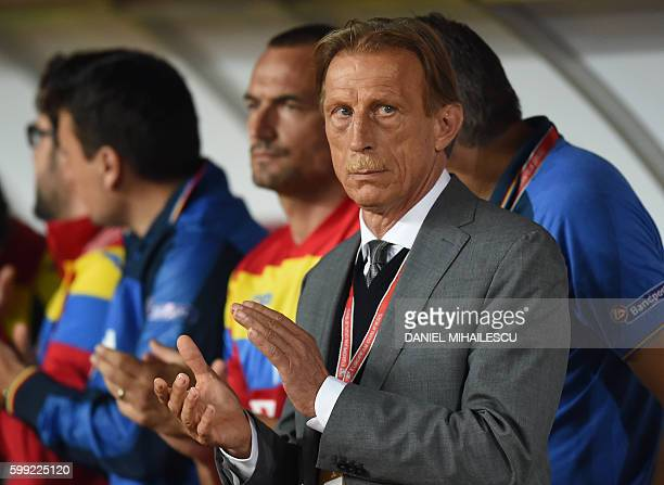 Romania's German coach Christoph Daum applauds prior to the World Cup 2018 football qualification match between Romania and Montenegro in ClujNapoca...