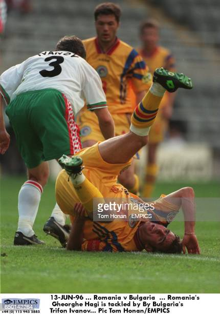 Romania's Gheorghe Hagi is tackled by By Bulgaria's Trifon Ivanov