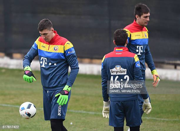 Romania's goalkeeper Costel Pantilimon attends a training session on March 26 on the eve of the friendly football match Romania against Spain in Cluj...
