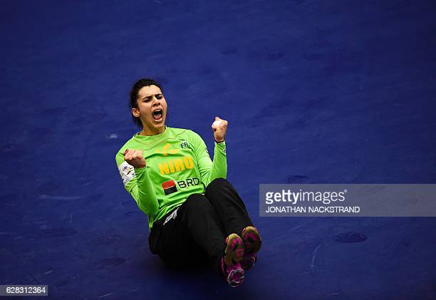 Romania's goalkeeper Denisa Dedu reacts after blocking a throw during the Women's European Handball Championship Group D match between Romania and...