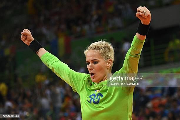 Romania's goalkeeper Paula Ungureanu celebrates after saving a ball during the women's preliminaries Group A handball match Norway vs Romania for the...