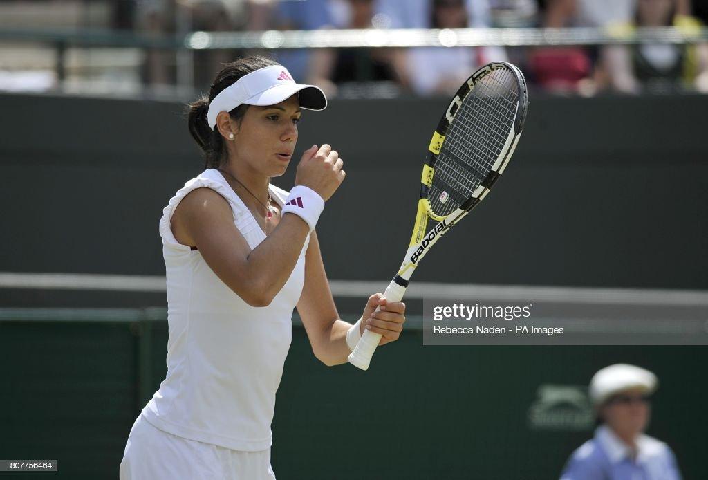 Romania's Ioana Olaru blows on her hand during her match against Russia's Maria Sharapova.