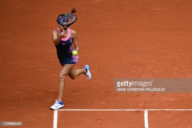 Romania's Irina Bara returns the ball to Sofia Kenin of the US during their women's singles third round tennis match on Day 7 of The Roland Garros...