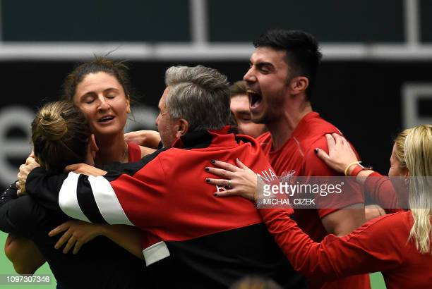 Romania's Irina-Camelia Begu celebrates with members of Romanian Fed Cup team after they defeated the Czech Republic in Fed Cup tennis match between...