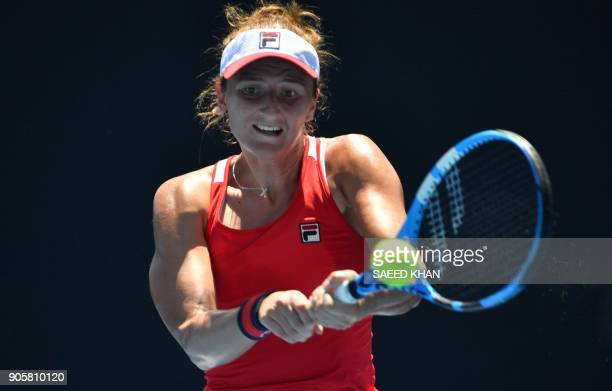 Romania's IrinaCamelia Begu hits a return against Croatia's Petra Martic during their women's singles second round match on day three of the...