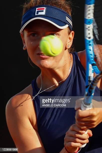 Romania's Irina-Camelia Begu plays a backhand to Britain's Johanna Konta on day four of the Women's Italian Open at Foro Italico on September 17,...
