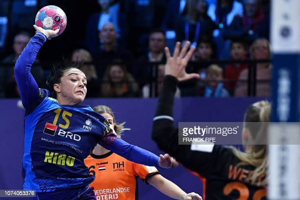 Romania's left wing ValentinaNeli Arden Elisei jumps to shoot during the EHF EURO 2018 European Women's Handball Championship 3rd Place match between...