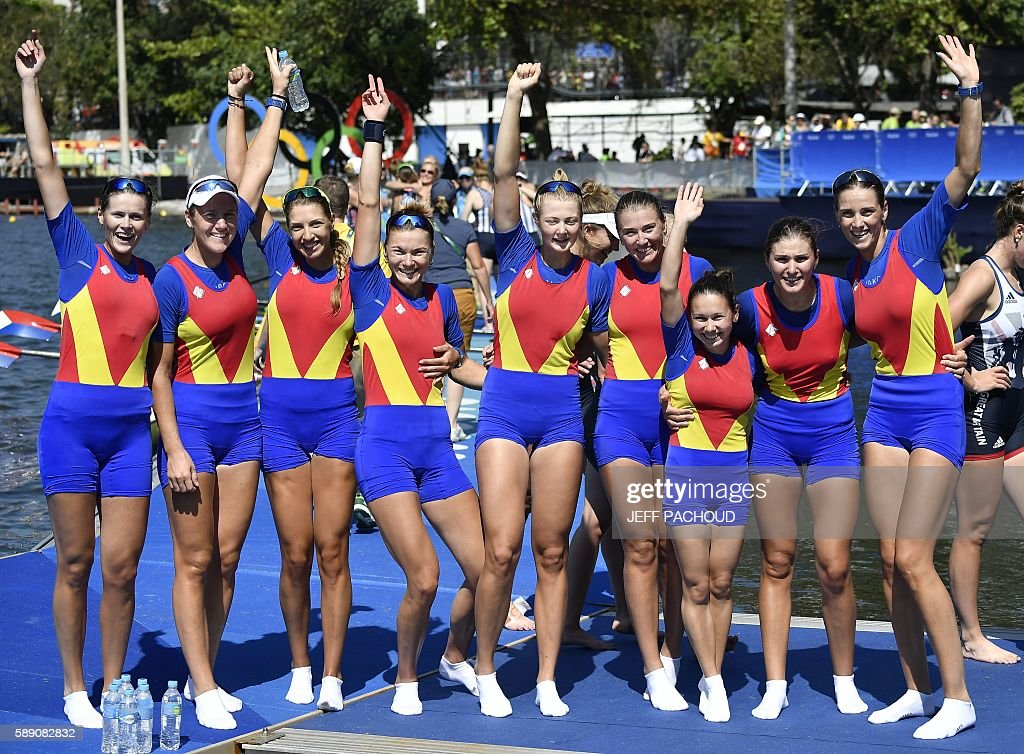 Romania's Madalina Beres, Romania's Andreea Boghian, Romania's Adelina Bogus, Romania's Roxana Cogianu, Romania's Daniela Druncea, Romania's Laura Oprea, Romania's Mihaela Petrila, Romania's Iuliana Popa and Romania's Ioana Strungaru celebrate after the Women's Eight final rowing competition at the Lagoa stadium during the Rio 2016 Olympic Games in Rio de Janeiro on August 13, 2016. / AFP / Jeff PACHOUD