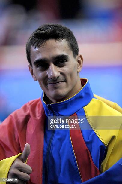 Romania's Marian Dragulescu celebrates after winning the men's floor event in the apparatus finals during the Artistic Gymnastics World Championships...
