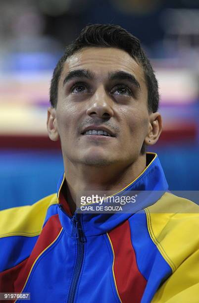 Romania's Marian Dragulescu looks at the scoreboard after performing in the vault event in the apparatus finals during the Artistic Gymnastics World...