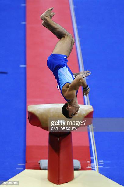 Romania's Marian Dragulescu performs in the vault event in the appatus finals during the Artistic Gymnastics World Championships 2009 at the 02 Arena...