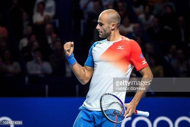 Romania's Marius Copil celebrates a winning point during his semi final tennis match against Germany's Alexander Zverev as part of the Swiss Indoors...