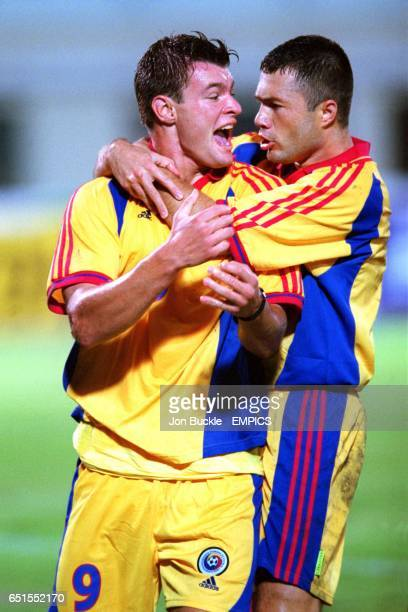 Romania's Marius Niculae celebrates scoring the second goal with teammate Adrian Ilie