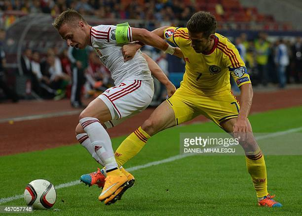 Romania's midfielder Alexandru Chipciu and Hungary's captain and midfielder Balazs Dzsudzsak vie for the ball during the Euro 2016 Group F qualifying...