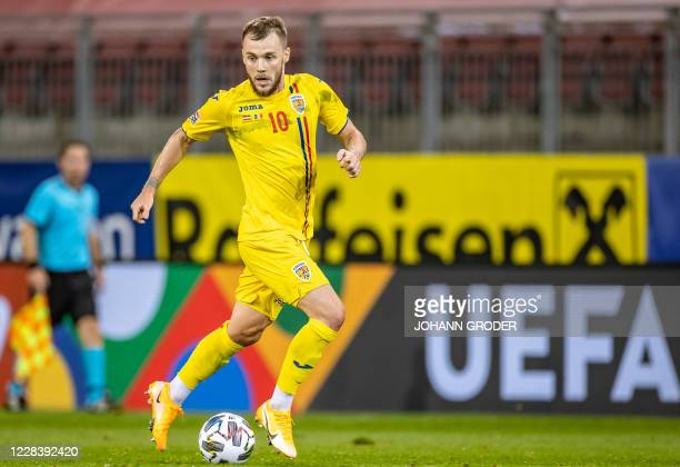 Romania's midfielder Alexandru Maxim runs with the ball during the UEFA Nations League football match between Austria and Romania on September 7,...