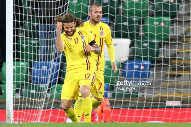 Romania's midfielder Eric Bicfalvi celebrates after scoring their first goal during the UEFA Nations League group b1 football match between Northern...