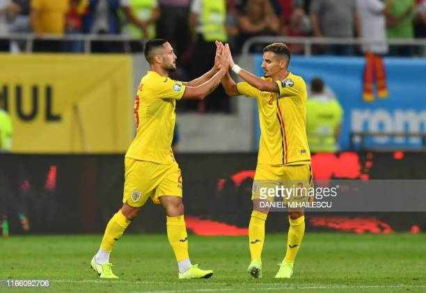 Romania's midfielder Florin Andone celebrates scoring with his teammate defender Romario Benzar during the Euro 2020 football qualification match...