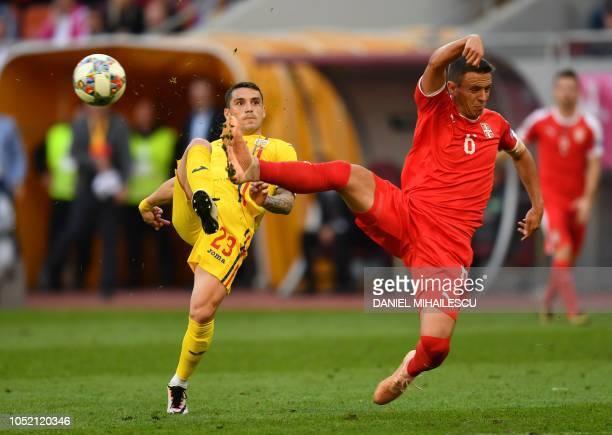 Romania's midfielder Nicolae Claudiu Stanciu vies for the ball with Serbia's midfielder Nemanja Maksimovic during the UEFA Nations League C Group 4...