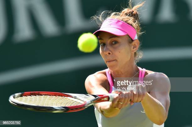 Romania's Mihaela Buzarnescu returns against Latvia's Jelena Ostapenko during their Women's singles third round match at the ATP Nature Valley...
