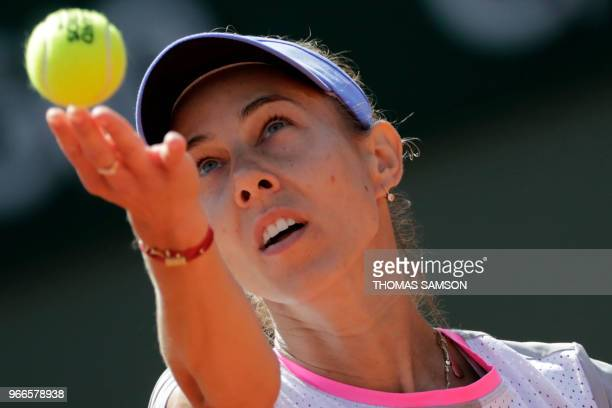 Romania's Mihaela Buzarnescu serves to Madison Keys of the US during their women's singles fourth round match on day eight of The Roland Garros 2018...