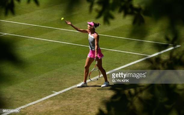 Romania's Mihaela Buzarnescu throws the ball to serve against Latvia's Jelena Ostapenko during their Women's singles third round match at the ATP...