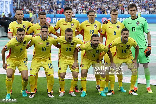 Romania's national football team poses for a group photo at the start of the Euro 2016 group A football match between France and Romania at Stade de...