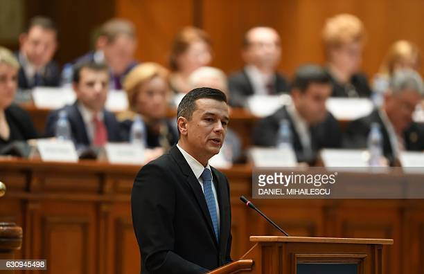 Romania's newly nominated Prime Minister Sorin Grindeanu speaks in the Romanian Parliament in Bucharest on January 4 2017 Grindeanu faces a...