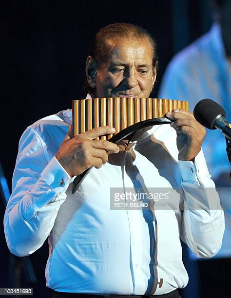 Romania's panpipes musician Gheorghe Zamfir performs during the 46th session of the International Carthage festival at the Romain theatre in Carthage...