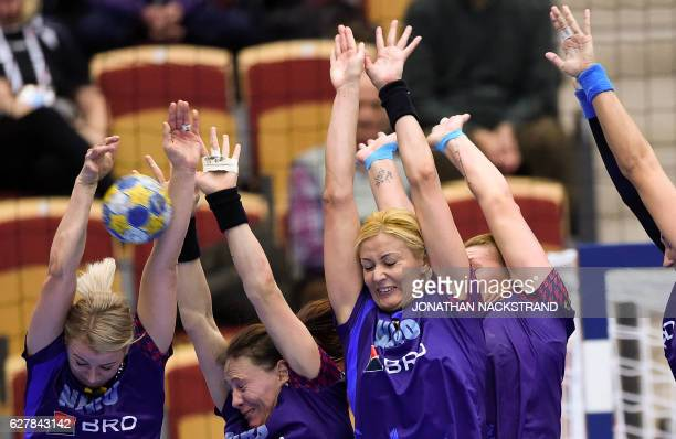 TOPSHOT Romania's players block a throw during the Women's European Handball Championship Group D match between Norway and Romania in Helsingborg...