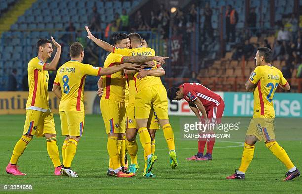 Romania's players celebrate a goal during the WC 2018 football qualification match between Armenia and Romania in Yerevan on October 8 2016 / AFP /...