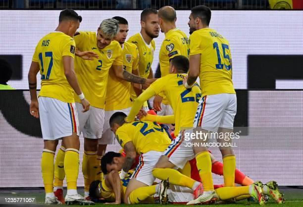 Romania's players celebrate after midfielder Ianis Hagi scored his team's first goal during the FIFA World Cup Qatar 2022 qualification Group J...