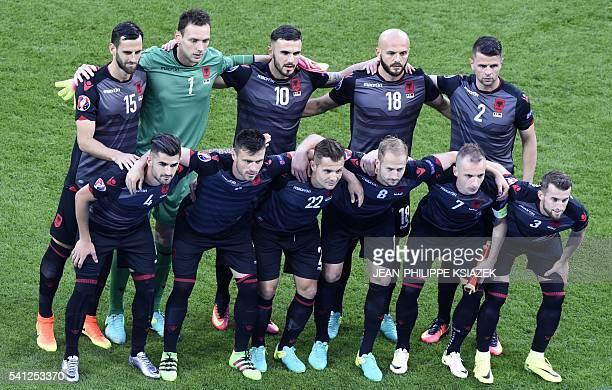 Romania's players Romania's defender Cosmin Moti Romania's forward Denis Alibec Romania's defender Cristian Sapunaru Romania's midfielder Mihai...