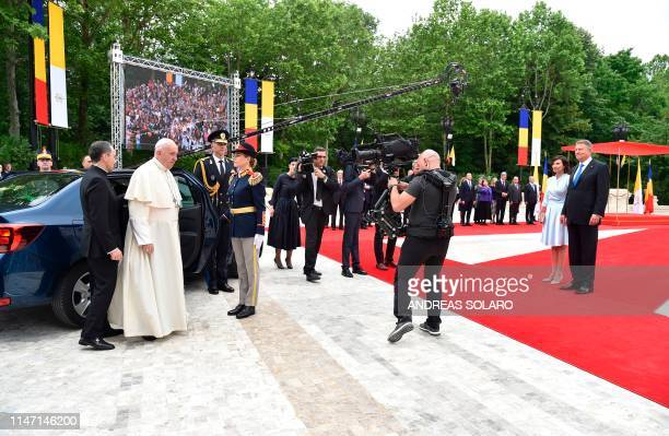 Romania's President Klaus Iohannis and his wife Carmen Iohannis wait to welcome Pope Francis arriving at the Presidential Palace in Bucharest on May...