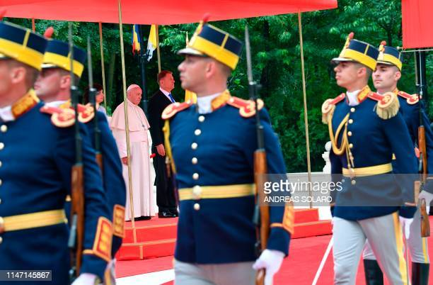 Romania's President Klaus Iohannis and Pope Francis inspect an honor guard at the Presidential Palace in Bucharest on May 31 2019 Pope Francis is...