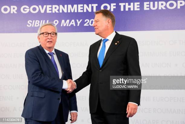 Romania's President Klaus Iohannis greets President of the European Commission JeanClaude Juncker arriving for a EU summit in Sibiu central Romania...