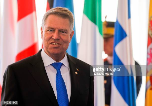 Romania's President Klaus Iohannis wait to greet delegates arriving for a EU summit in Sibiu central Romania on May 9 2019 European Union leaders...