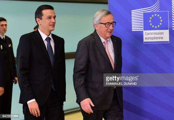 Romania's Prime Minister Sorin Grindeanu is welcomed by European Commission President JeanClaude Juncker at the European Commission in Brussels on...