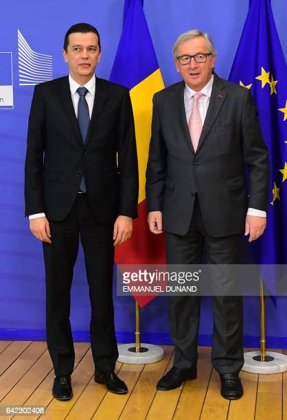 Romania's Prime Minister Sorin Grindeanu poses with European Commission President JeanClaude Juncker upon his arrival at the European Commission in...