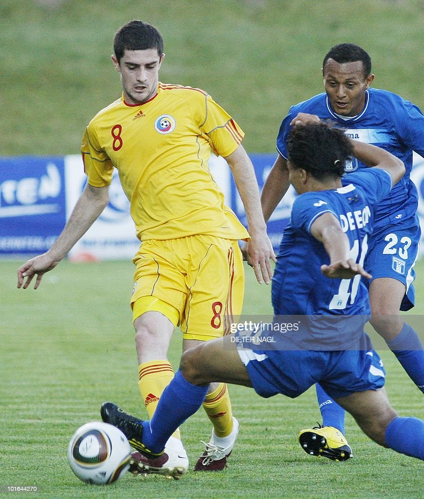 Romania's Razvan Cocis (L) vies for the ball with Honduras player Julio De Leon in a friendly game on June 5, 2010 in St. Veit some 300 kilometer south-west of Vienna.