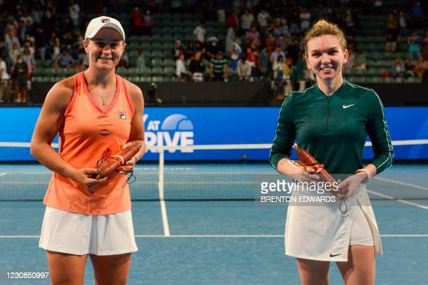 Romania's Simona Halep and Australia's Ashleigh Barty pose for photographs after their women's singles match at the 'A Day at the Drive' exhibition...