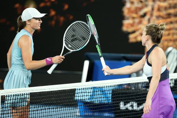 Romania's Simona Halep and Poland's Iga Swiatek greet each other after their women's singles match on day seven of the Australian Open tennis...