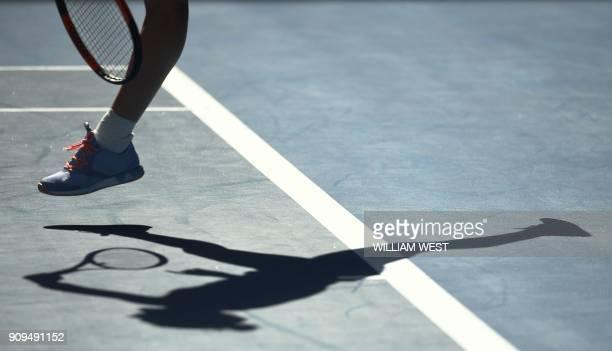 Romania's Simona Halep casts a shadow as she hits a return against Czech Republic's Karolina Pliskova during their women's singles quarterfinals...