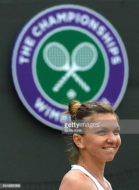 Romania's Simona Halep celebrates after beating US player Madison Keys during their women's singles fourth round match on the eighth day of the 2016...