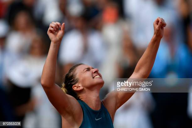 Romania's Simona Halep celebrates after victory over Sloane Stephens of the US during their women's singles final match on day fourteen of The Roland...