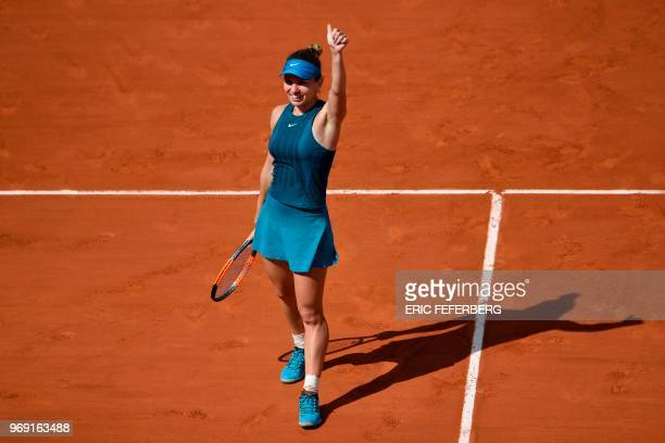 Romania's Simona Halep celebrates after victory over Spain's Garbine Muguruza at the end of their women's singles semi-final match on day twelve of...